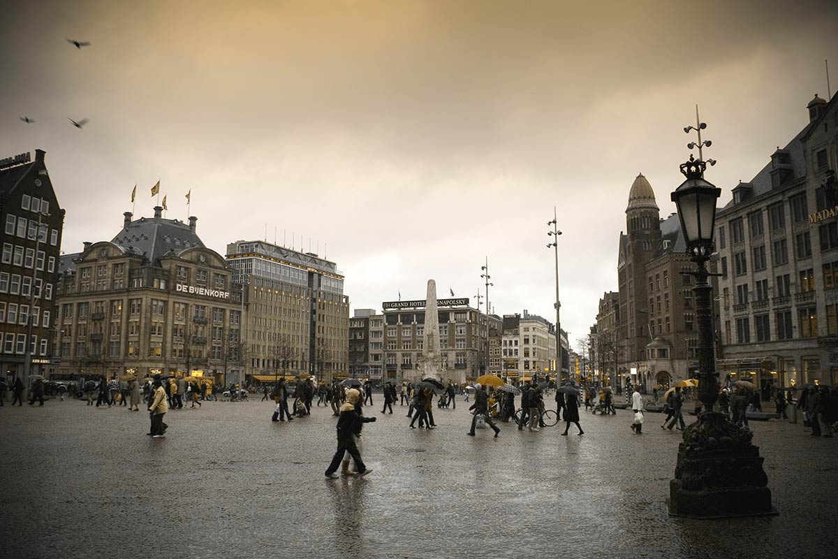 fotografie regen Dam Amsterdam fotograferen foto cursus tip